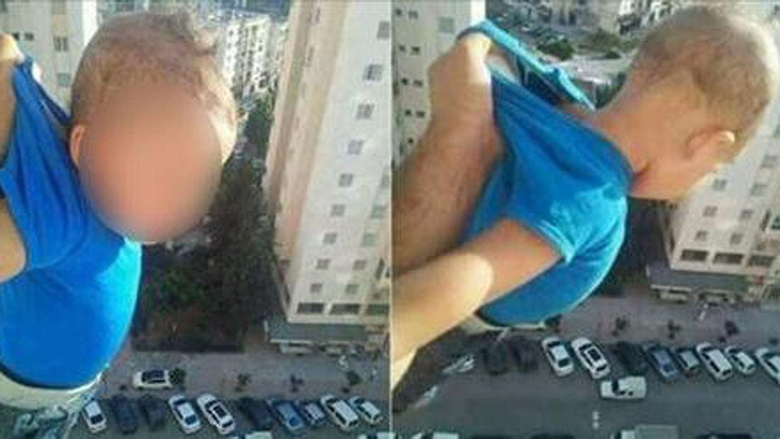 Weil er Facebook-Likes wollte: Mann hält Baby aus Fenster in 15. Stock