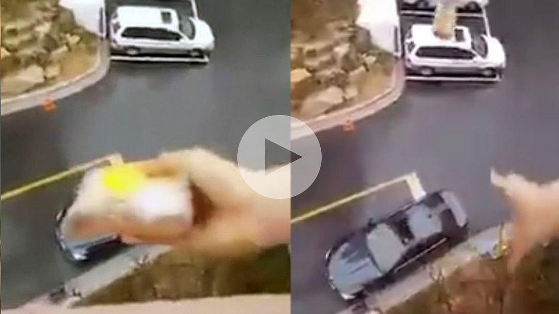 Eine japanische Frau wirft den Snack ihres Mannes aus dem 5. Stock durch das Schiebedach seines Autos