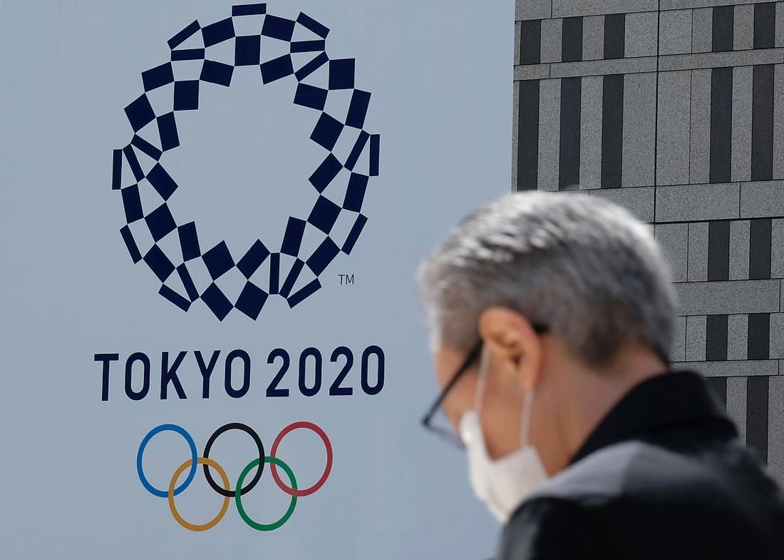 Olympia 2020 in Japan und Mann mit Atemmaske