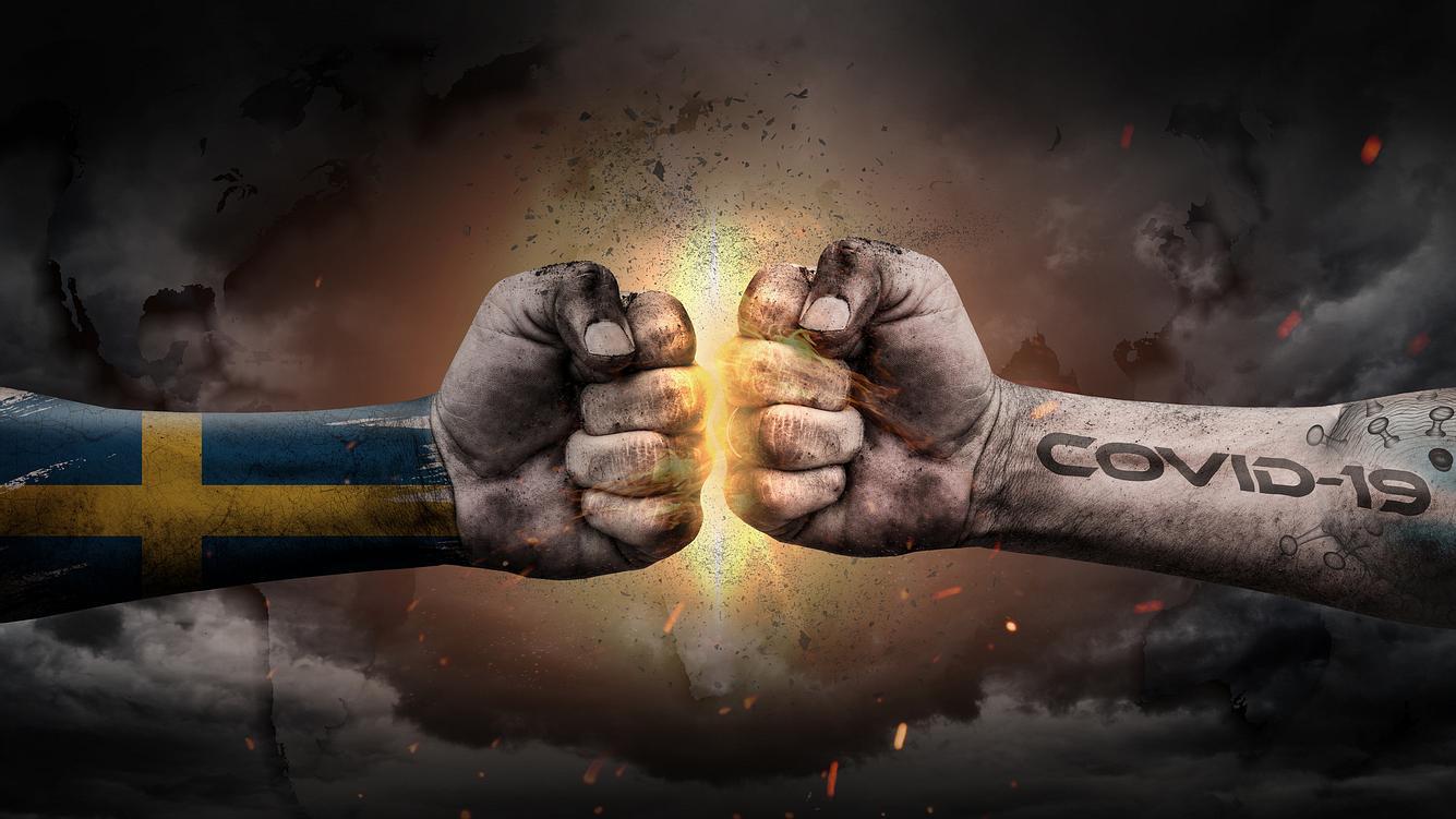 Aufeinanderprallende Fäuste als Symbol für Schwedens Kampf gegen Covid-19