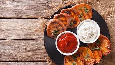 Süßkartoffeln vom Grill - Foto: iStock / ALLEKO