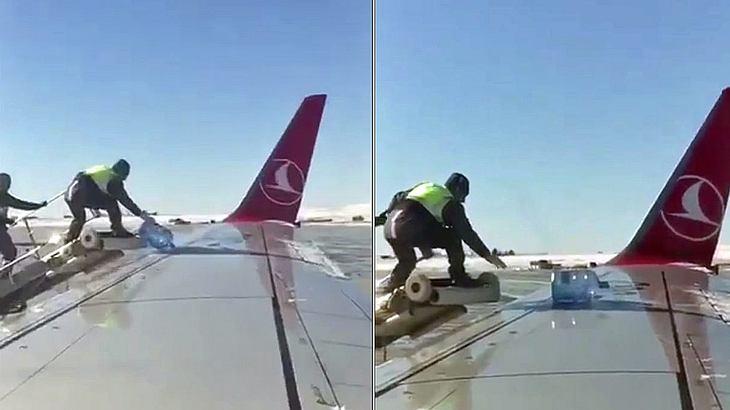 Zwei Mitarbeiter von Turkish Airlines enteisen auf einem türkischen Flughafen ein Flugzeug